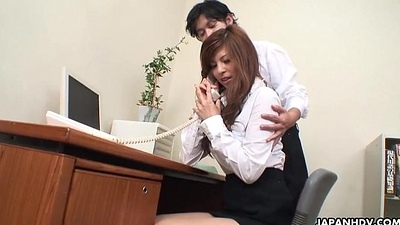 Oriental cuttie getting toy fucked at the office