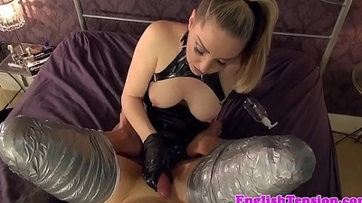 BDSM mumifies sub before jerking cock