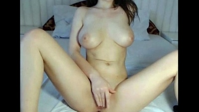 Attracting big breasted brunette playing on cam