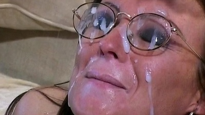Brunette receives a mass of jizz on her nerdy glasses