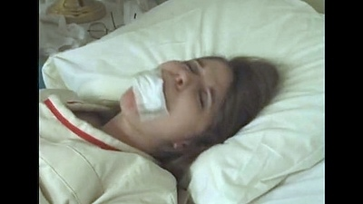 Pretty brunette in Straitjacket taped mouth forced constrained to bed polyclinic