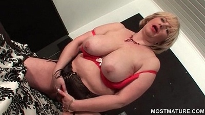 Sexy mature flashing her bald cunt and boobs